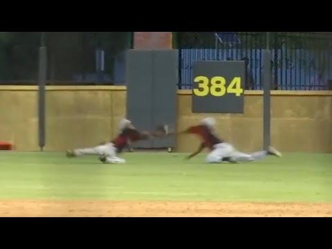 Outfielders collide for incredible diving catch