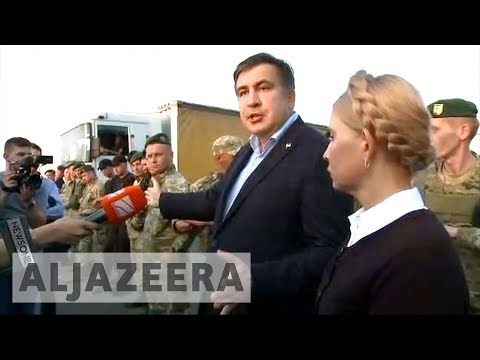 Ex-Georgian leader Mikhail Saakashvili forces his way into Ukraine