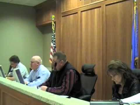 Rogers County Commissioners Mike Helm and Kirt Thacker vote