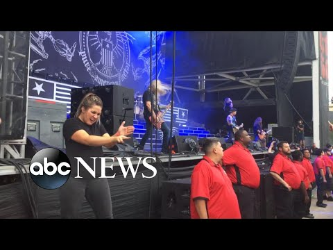 Sign language interpreter rocks out at heavy metal concert Mp3