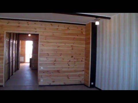 Имитация бруса и деревянные балки в интерьере квартиры