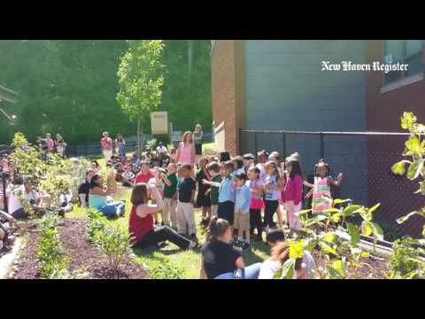 Kindergarten students at Bishop Woods School perform at a dedication ceremony for the school's new s