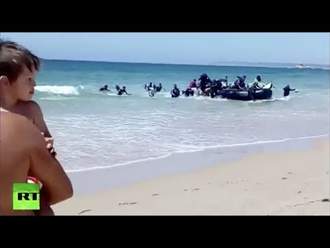 Boat with African migrants shocks sunbathers on Spanish beach