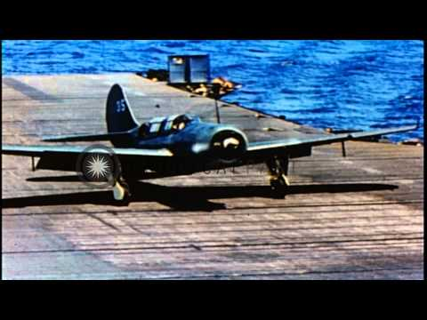 TBF Avengers, F6F Hellcats, A-25, SB2C and SBF Helldivers land on the deck of 'Th...HD Stock Footage