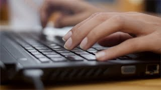 Closeup shot of women hand's typing on computer keyboard