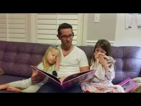 Daddy reads Holland's baby book