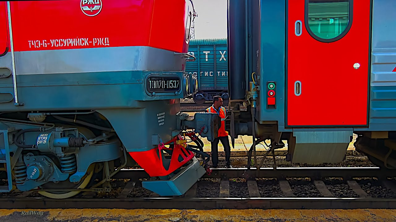 Decoupling diesel locomotive TEP70-0537 from the passenger train at the Ussuriysk station. Russia