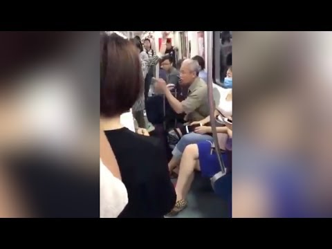 Elderly man tells someone off in English on the subway