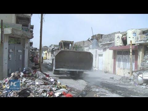 Iraqi civilians living in ruins of Mosul battle