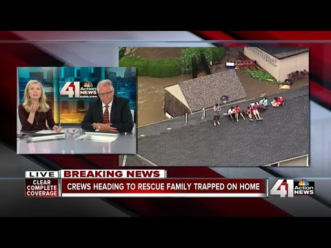 Family of 7 stranded on rooftop in Overland Park