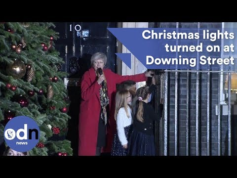 Theresa May switches on 10 Downing Street Christmas Tree lights