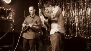 "Lonesome trio plays ""House Song"" the Parkside Lounge"