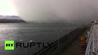 Freak snow storm swallows bridge in Siberia