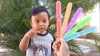 Reihan loves his colorful ice cream