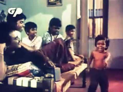 Rajinikanth making a boy dance on his tunes.