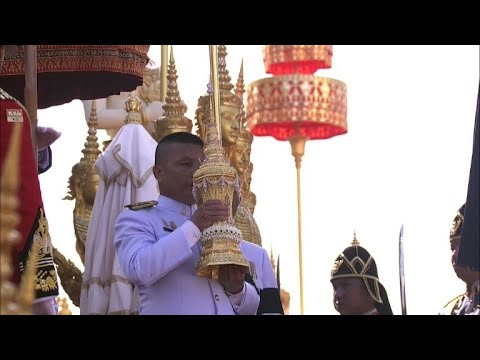 Relics picked from late Thai King's ashes