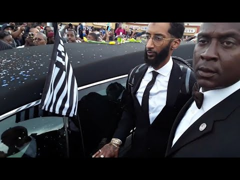 Nipsey Hussle casket makes one more round in front of his business empire in Los Angeles California.