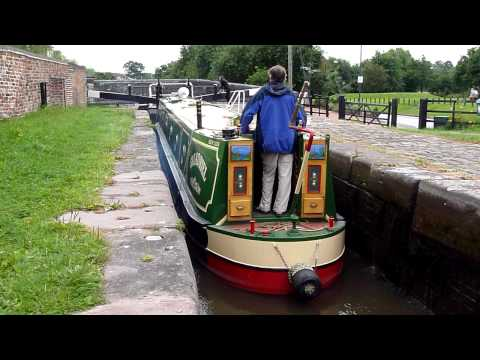 English Canal Narrowboat going through a Lock in Stone Staffordshire August 2010 by Workhouse Bridge