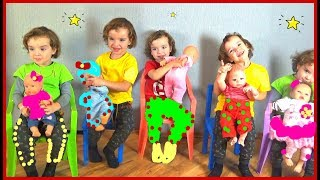 Makar plays with dolls