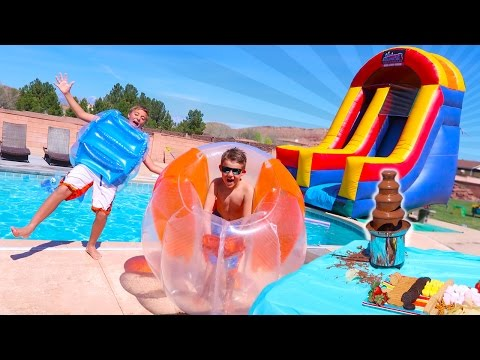 Thumbnail: GIANT BUBBLE BALL INFLATABLE SLIDE IN THE POOL FUN SURPRISE PARTY!!