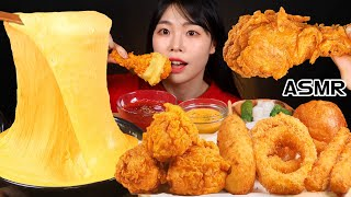 Cheese fondue, fried chicken, onion rings, cheese balls, cheese sticks, eating
