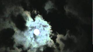 Crazy moon appears to be beneath the clouds