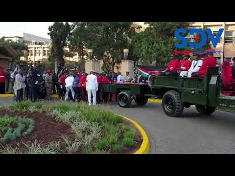 Military officers offload the casket holding Mzee Moi's body off the carriage