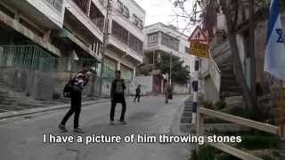 Hebron: Palestinian kids throwing stones at soldiers