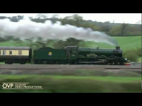 A GWR Castle at speed - 5043 Earl of Mount Edgcumbe racing alongside the M5