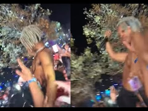 xxxtentacion defends himself from a fan who punched him while he performed from the crowd.