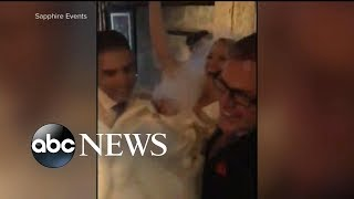 Couple get married in torrential rain