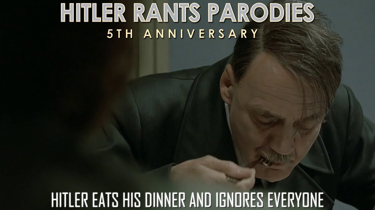 Hitler eats his dinner and ignores everyone