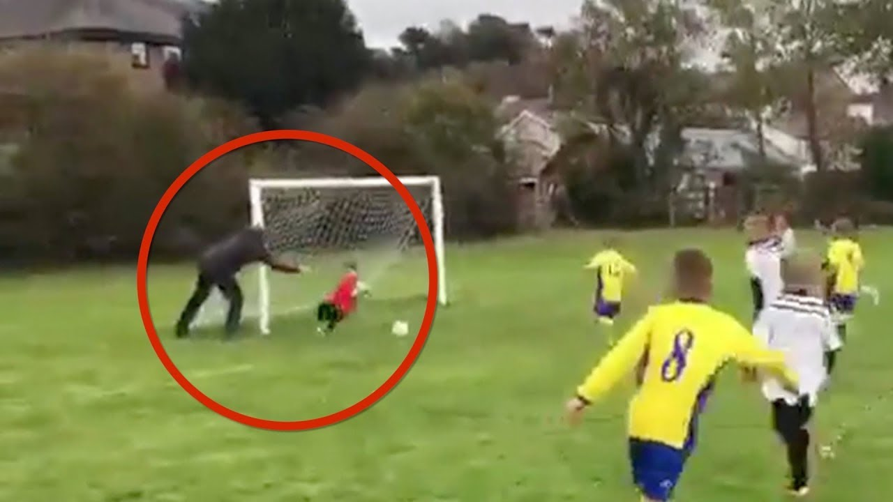 Dad Goes Viral After Pushing Son To Save Goal