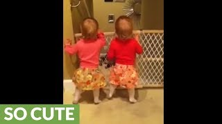 Identical twins thrilled when daddy comes home