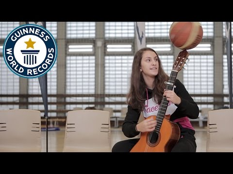 Longest time spinning a basketball on a guitar – Guinness World Records