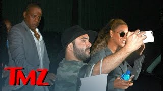 Jay Z Manhandles Crazed Beyonce Fan by : TMZ