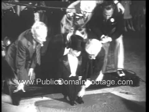 1938 Charlie McCarthy imprints feet at Grauman's Chinese Theatre archival footage