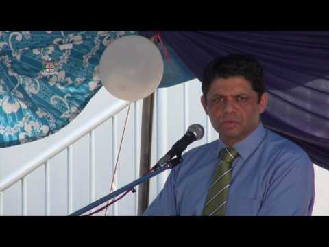 FIJIAN ATTORNEY GENERAL ISSUING THE FIRST PASSPORT PRINTED IN LABASA'S IMMIGRATION OFFICE