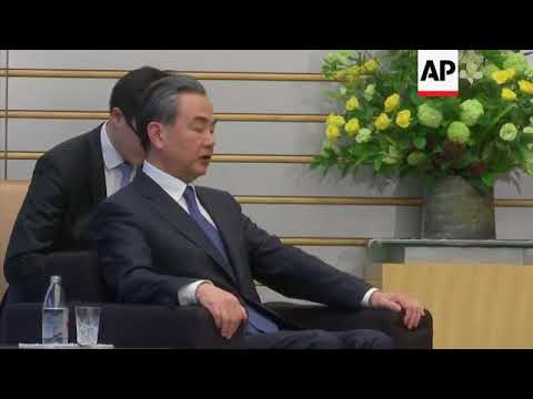 Wang stresses importance of free trade as he meets Abe in Japan