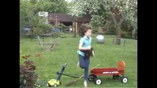 Toy Hobby Horse Jumping In The Garden!
