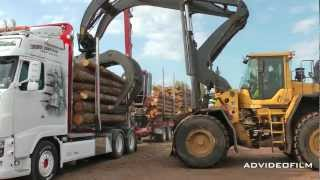 unloading timber truck with high lift