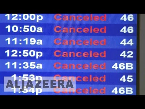 Thousands of flights cancelled as snowstorm hits northeast US