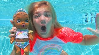 Maggie Swimming with the Doll
