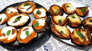 490 - Pizzette di melanzane...ci vò avanti a settimane! (antipasto goloso e facile in due varianti)