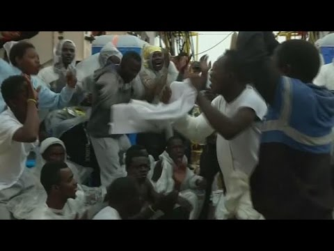 Rescued migrants sing and dance on journey to Italy and safety