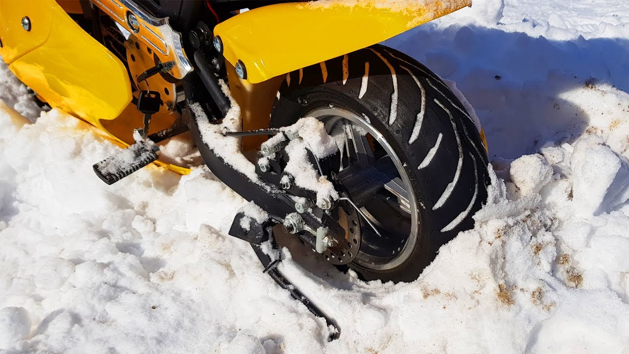 Dad's power wheels Bike stuck in the snow