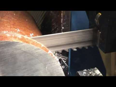 Roentgen bandsaw blade cutting through a 200mm mild steel billet