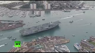 AERIAL  UK's HMS Queen Elizabeth flagship carrier sails into Portsmouth