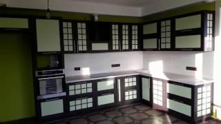 Кухня с рамочным фасадом Г-образной формы