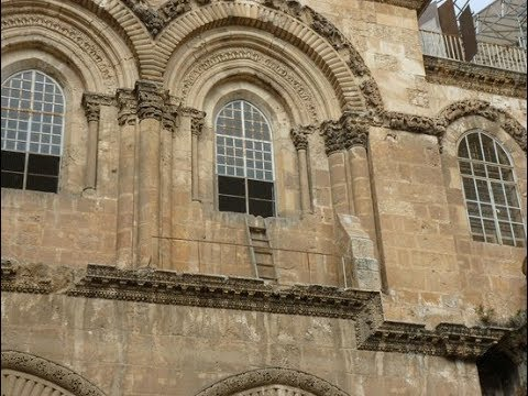 Why is there a ladder at the front of the Church of the Holy Sepulchre Jerusalem Israel?
